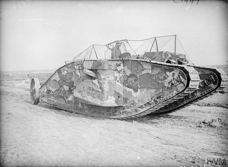 The first official photograph taken of a Tank going into action, at the Battle of Flers-Courcelette, 15th September 1916. The man shown is wearing a leather tank helmet.