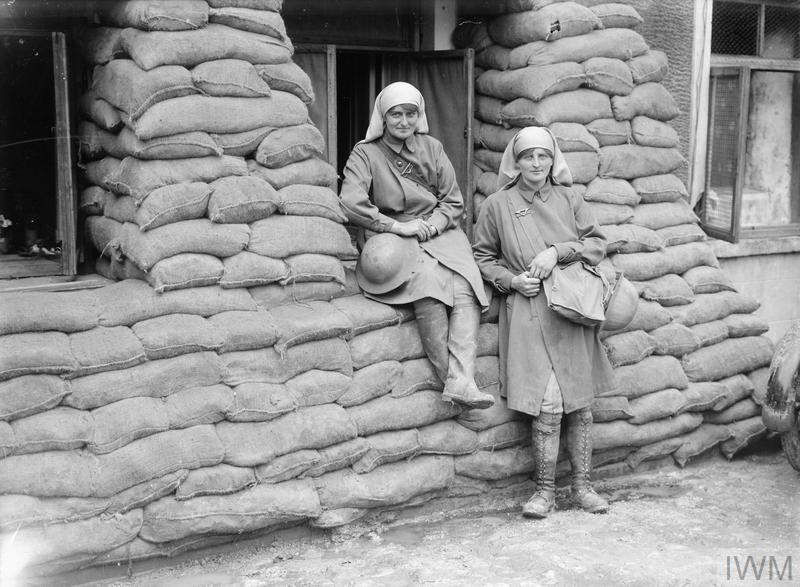 "Elsie Knocker, the Baroness de T'Serclaes, and Mairi Chisholm (""The Madonnas of Pervyse"") outside their sandbagged third ""Posts"" in Pervyse, 30th July 1917."