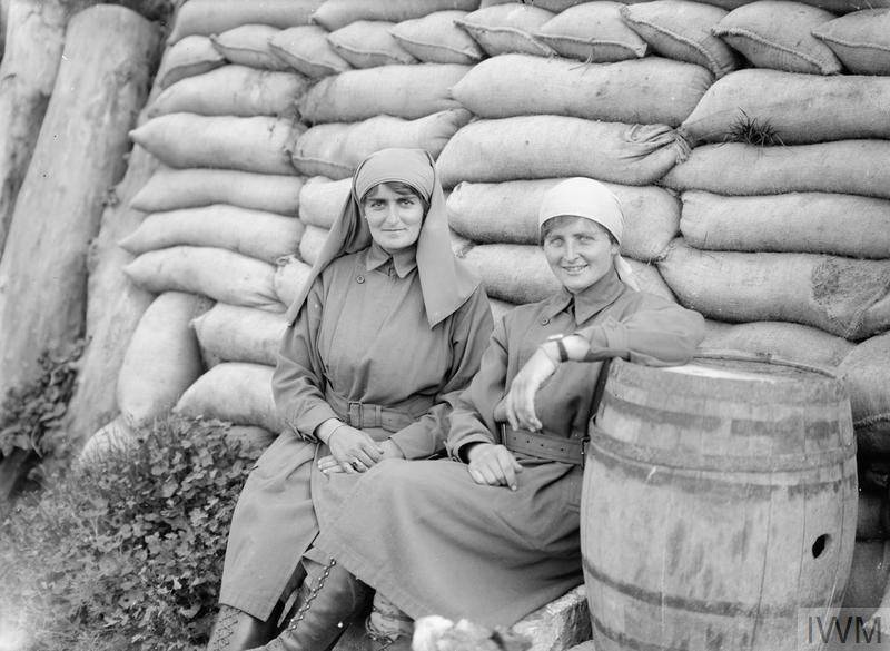 "Baroness T'Serclaes and Miss Mairi Chisholm outside their sandbagged third ""poste"" in Pervyse, 9 September 1917."
