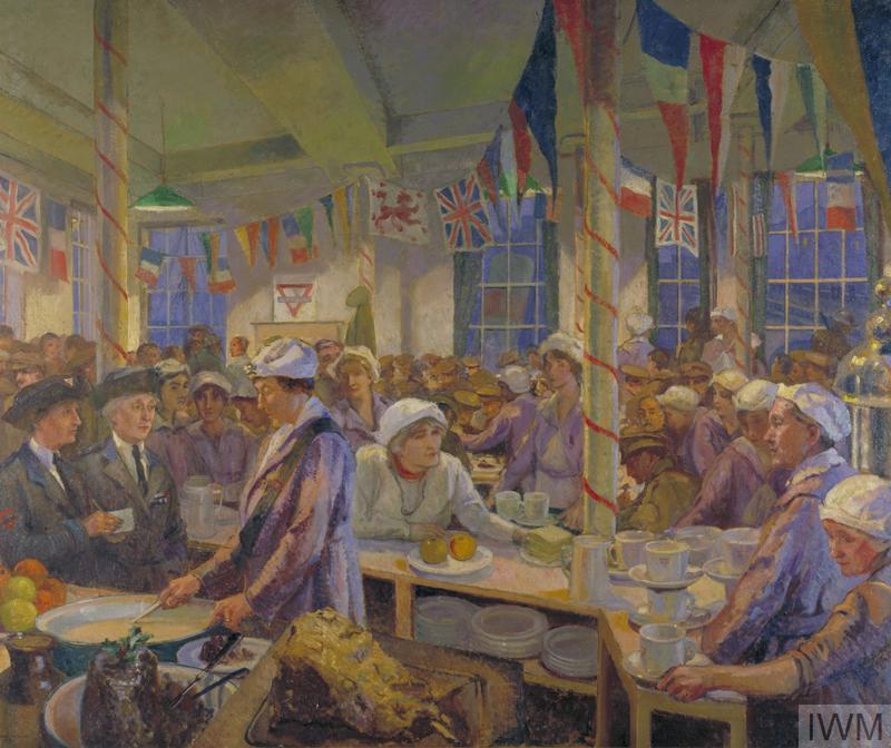 The interior view of a canteen with flags of the allied countries hanging like bunting along the top of the room. On the right the room is crowded with soldiers awaiting their meal. In the foreground and left are women preparing to serve them.