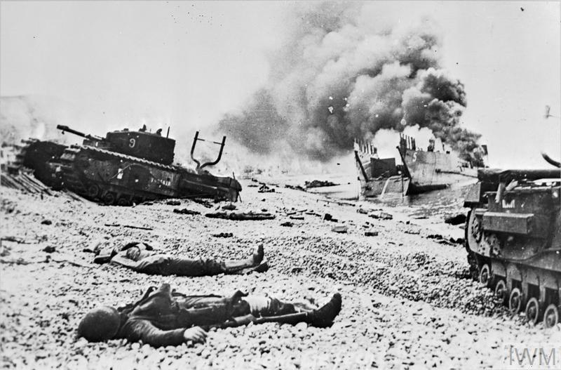 Tanks and landing craft burning on the beach after the Allied raid on Dieppe.