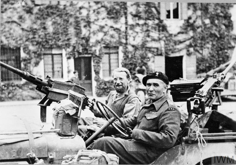 © HU 1122 Lieutenant Colonel Vladimir 'Popski' Peniakoff, the commander of 'Popski's Private Army', with his gunner, Corporal R Cokes, in their jeep in Italy.