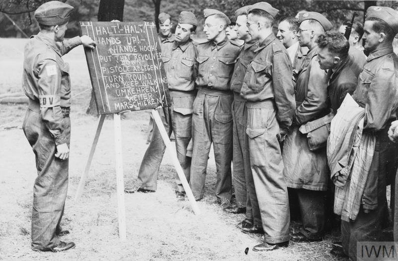 The Local Defence Volunteers: Members of the Local Defence Volunteers being taught simple German phrases.