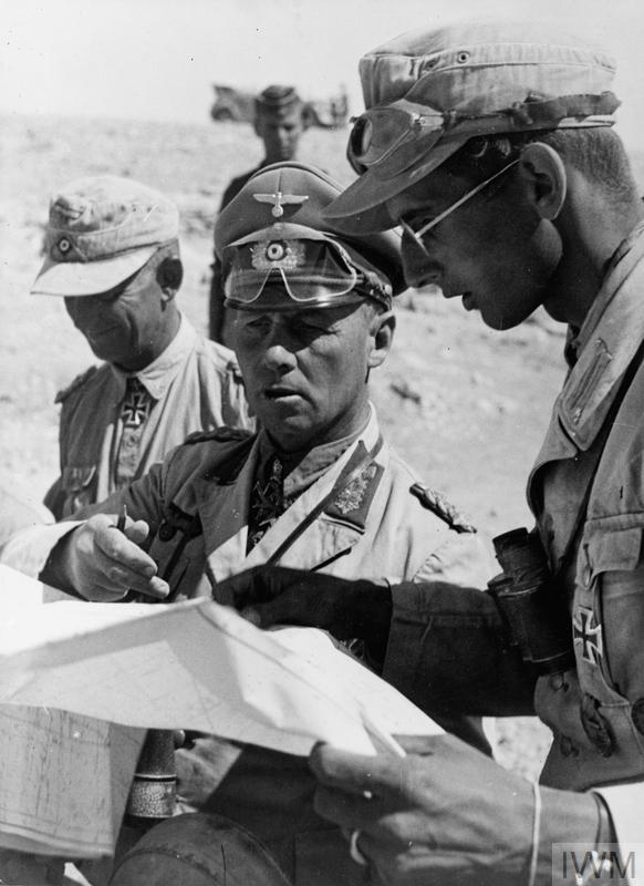 Field Marshal Erwin Rommel, Commander of the German forces in North Africa, with his aides during the desert campaign.