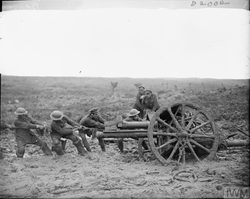 Battle of Pilckem Ridge. Gunners of the Royal Field Artillery jacking and hauling a field gun out of the mud. North of Ypres, 2 August 1917.
