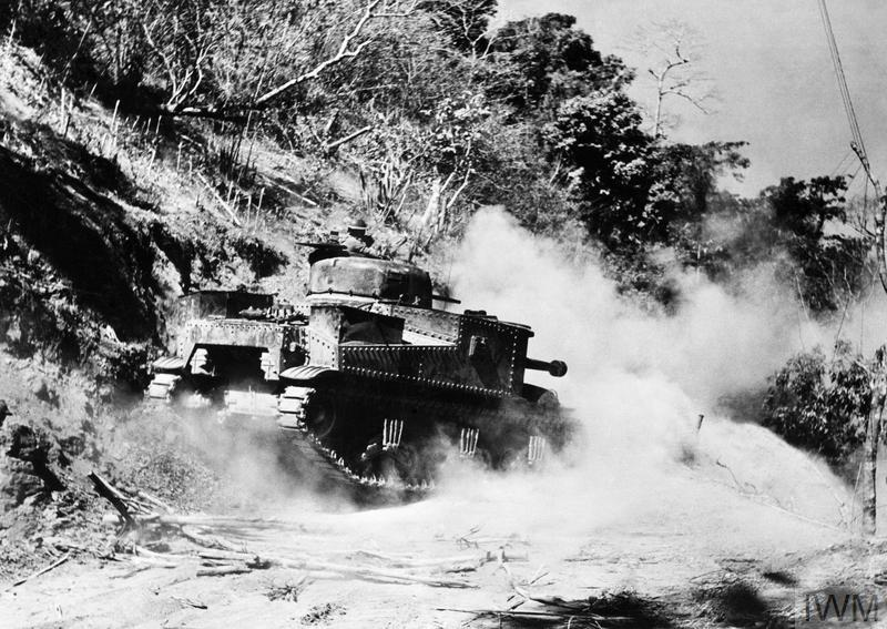 A General Lee tank travelling on the top of the Ngakyedauk Pass to engage camouflaged Japanese positions.