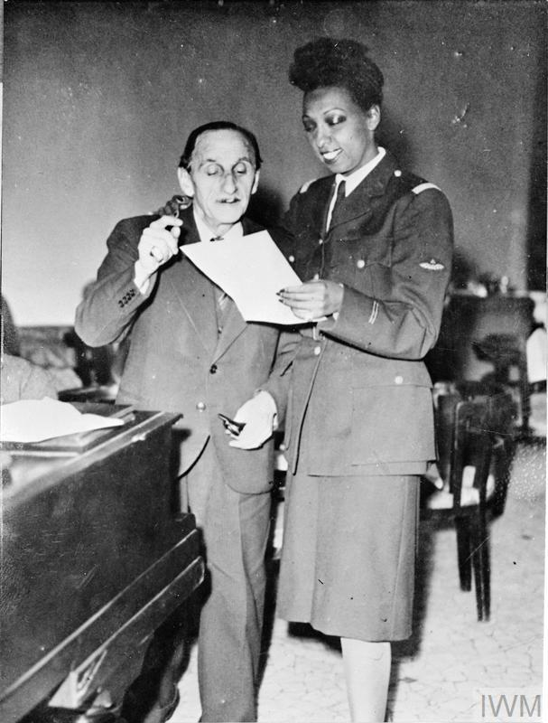 Josephine Baker rehearses a new song with Vincent Scotto in liberated Paris.