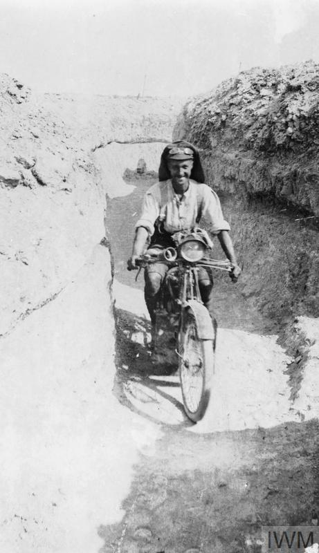 Despatch rider of the Royal Naval Division Signal Company returning through a communication trench from Brigade Headquarters.