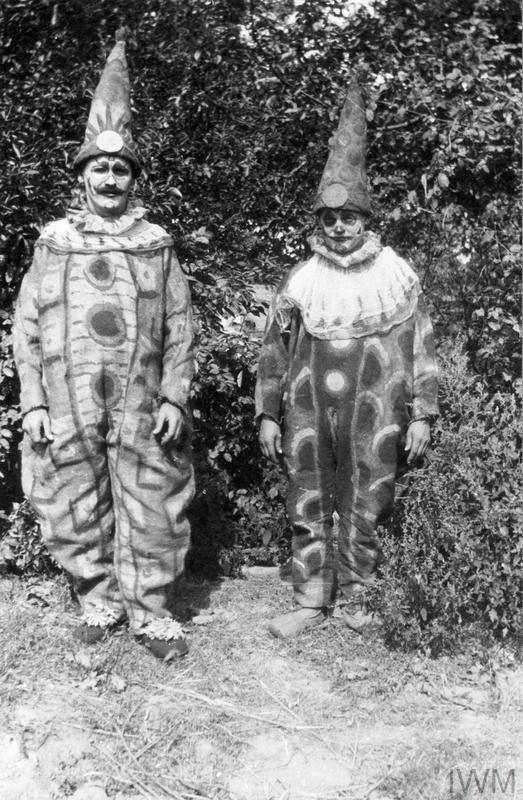 Leisure and entertainment at the Front: Two German prisoners of war wearing clown costumes made of sacking for a theatrical entertainment at 360 POW Company, France. Such entertainments were a particular feature of camp life for prisoners on both sides. However prisoners had to rely almost entirely on their own limited resources for costumes and scenery.