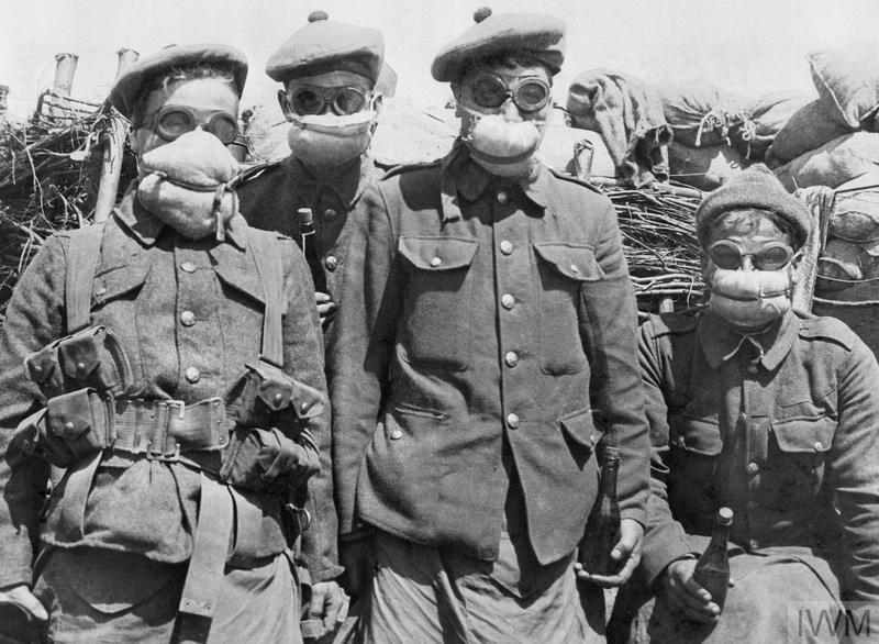 Men of the 2nd Argyll and Sutherland Highlanders wearing cotton-waste pad-respirators, 1915.