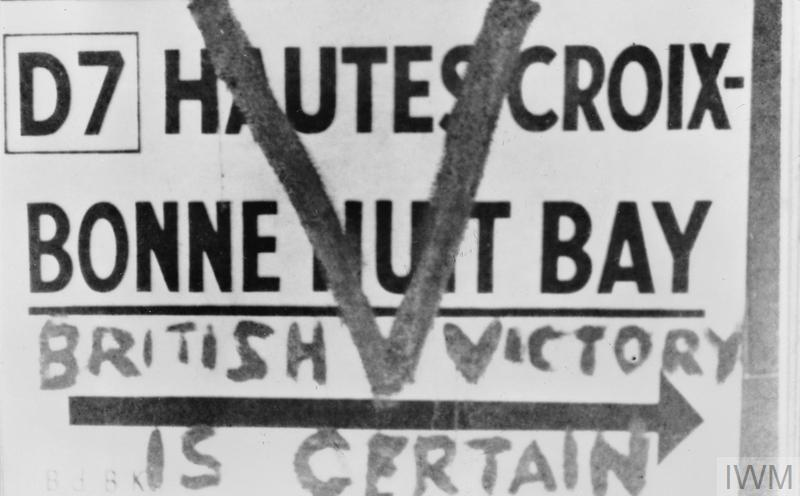 Jersey: Road sign in St Helier daubed with a 'V for Victory' sign and the slogan 'British victory is certain' by islanders, who faced fines and imprisonment if caught.