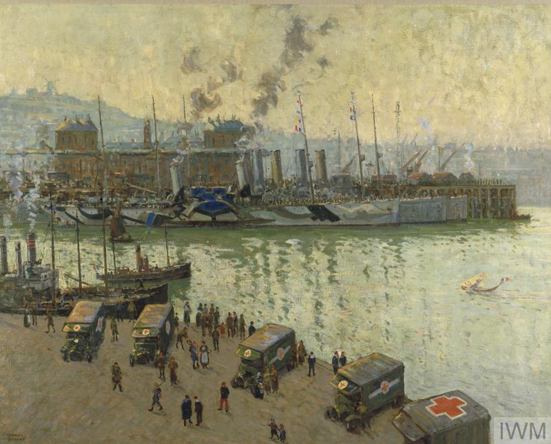 A view of the quayside at Boulogne. Red Cross ambulances are parked on the quay with nurses and soldiers standing by the vehicles. A small flying boat floats on the harbour to the centre right. Troopships painted in dazzle camouflage are moored at the opposite quay; they are filled with troops going on leave.