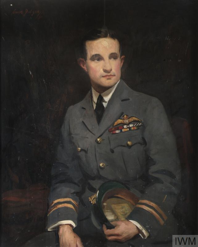 A half length portrait of Beauchamp-Proctor in full uniform holding his cap in his left hand. All is set against a dark background.