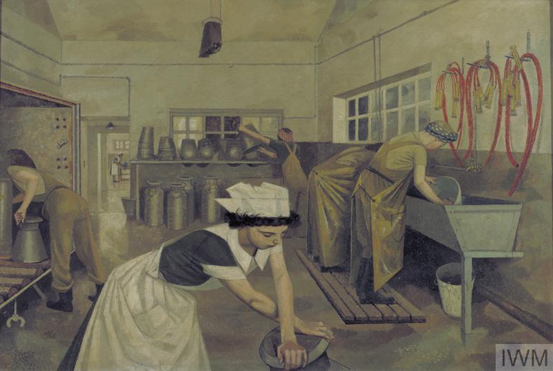 Inside a dairy with women washing equipment and another rolling a milk-churn in centre foreground.