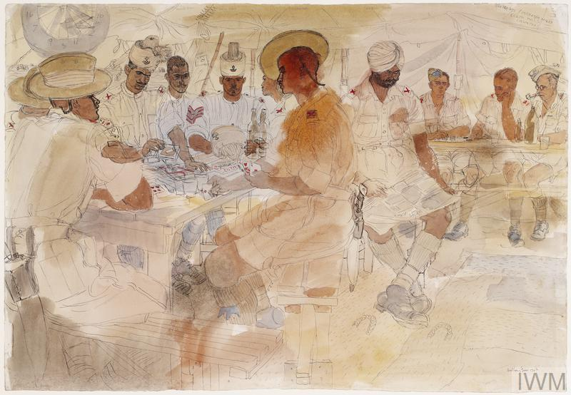 Soldiers of the 4th Indian Division relax in a tent in the desert. On the left, six soldiers play cards and on the right a soldier reads the newspaper and two others play draughts.