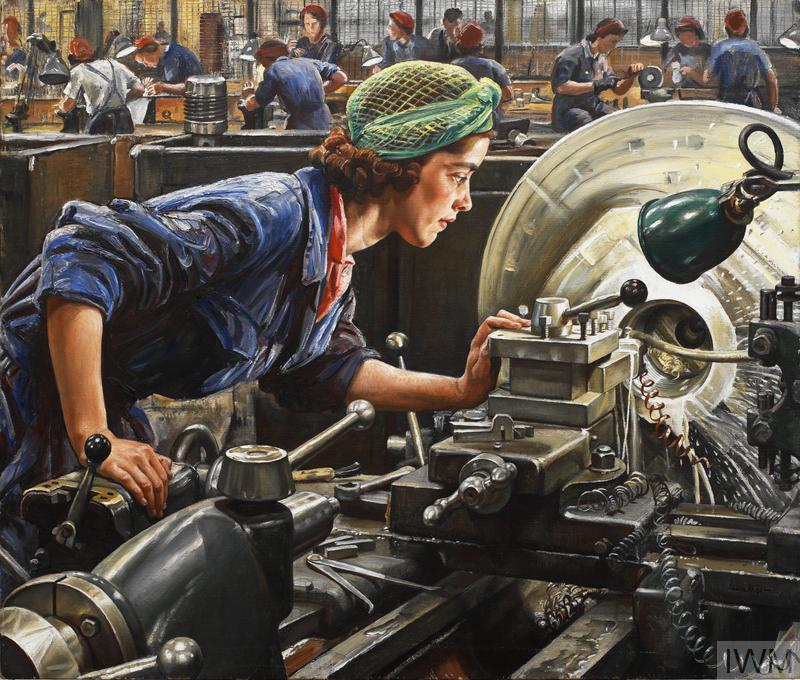 portrait of a female factory worker operating a lathe.