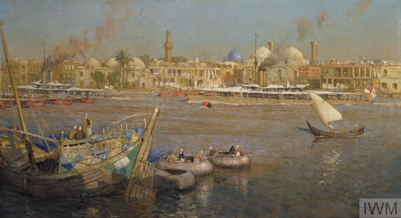 A view of the harbour at Baghdad. In the foreground there are several wooden boats, and beyond this British naval ships moored on the far side of the harbour.