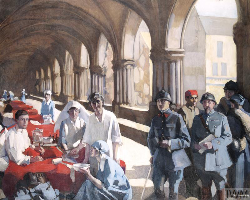 A view along the cloister of an abbey, in which there is a row of beds filled with patients on the left. In the left foreground three nurses tend to a male patient, who sits up in bed.