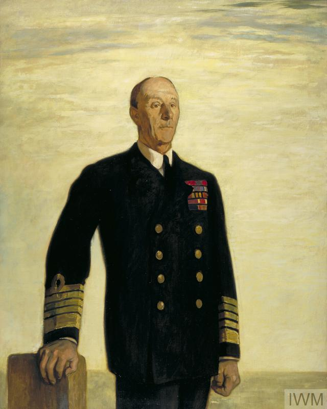 A three quarter-length portrait of Jellicoe in uniform. He stands with the sea, horizon and a golden sky behind resting one hand on a post.