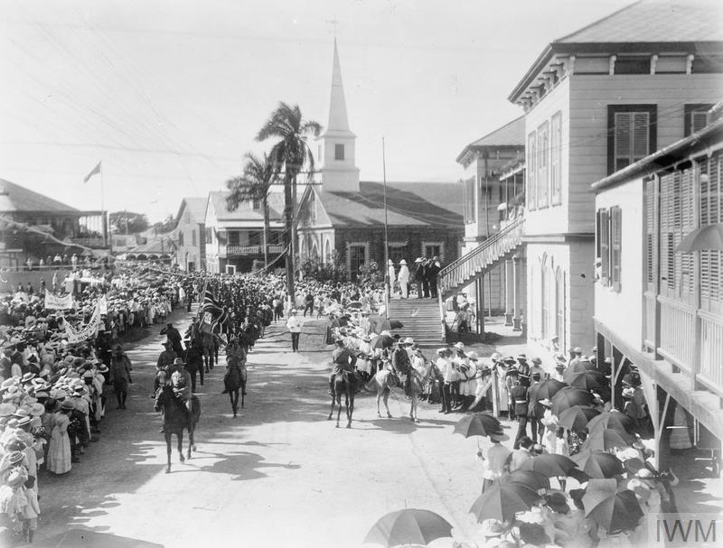 West Indian troops march through Kingston, Jamaica, on their way to the harbour, 1916.