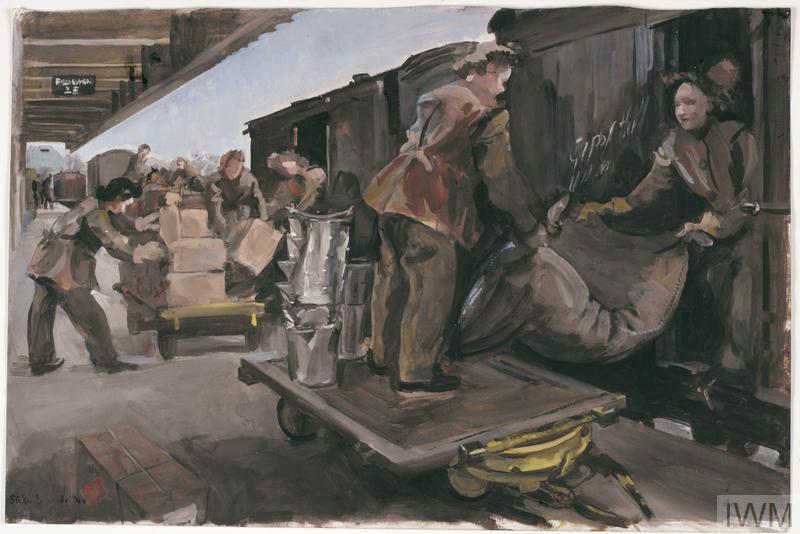 ATS attached RAOC : Unloading a train at the depot siding at Ashford, Kent, 1944