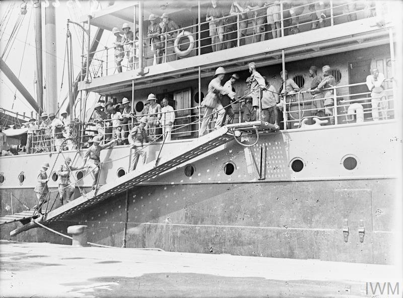 German East African Campaign. General Cunliffe, (GOC Nigerian Brigade) and Staff going aboard HMT MENDI. The Mendi was sunk when crossing from England to Havre on 21st February 1917, by collision, with a loss of 10 European Officers, and NCO's and 615 South African Natives. Calabar, November 1916.