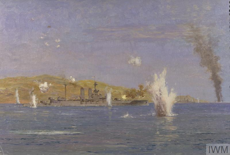 A view of the HMS Queen Elizabeth under heavy fire from shore-based batteries. Her forward guns return fire, aiming out towards the right of the composition. There are several thick sprays of water rising from the surface where gunfire has sunk into the sea. Closer to the ship there are several puffs of gunfire hanging in the air. A green stretch of land lies in the background, and a tall column of dark smoke rises up into the sky from the horizon in the right of the composition.