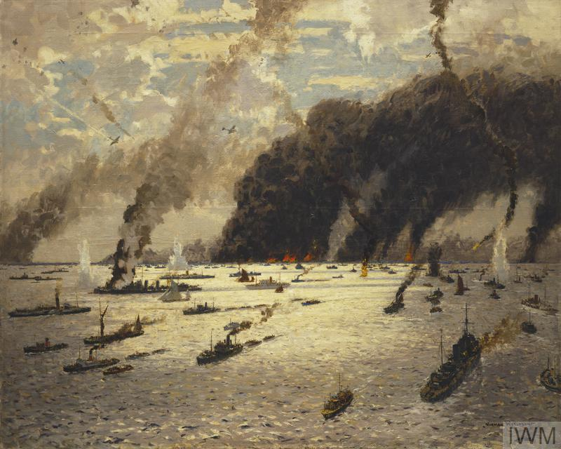 A view over a sea filled with vessels of different sizes. Fires burn on the horizon filling the sky with clouds of thick grey smoke. There are several planes above, trails of thick smoke, and explosions on the water amongst the boats.