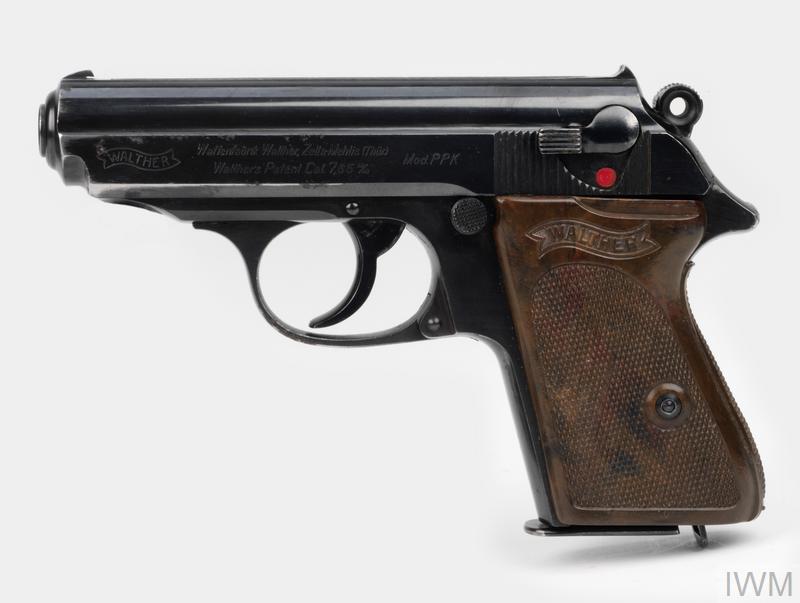 pistol & magazine (7) 60 degree safety, brown grips.