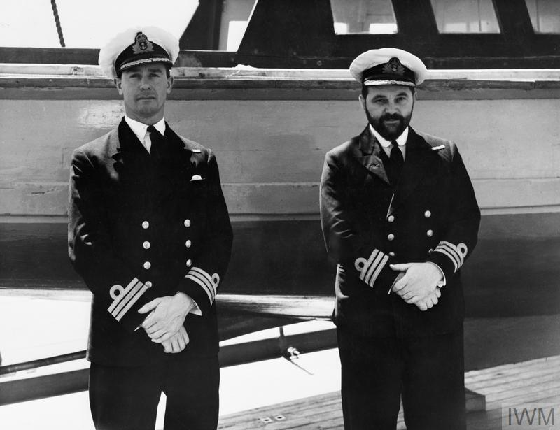 Commander Edward Fowle Pizey DSC, Commander of HMS PORPOISE with Commander John Wallace Linton DSC VC, Commander of HMS TURBULENT. Linton was posthumously awarded the Victoria Cross on 25 May 1943 for his actions in the Mediterranean, 1942-1943.