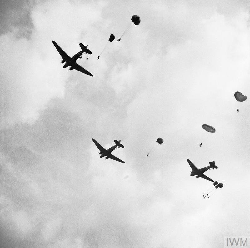 Paratroops drop from Dakota aircraft over the outskirts of Arnhem, 17 September 1944.