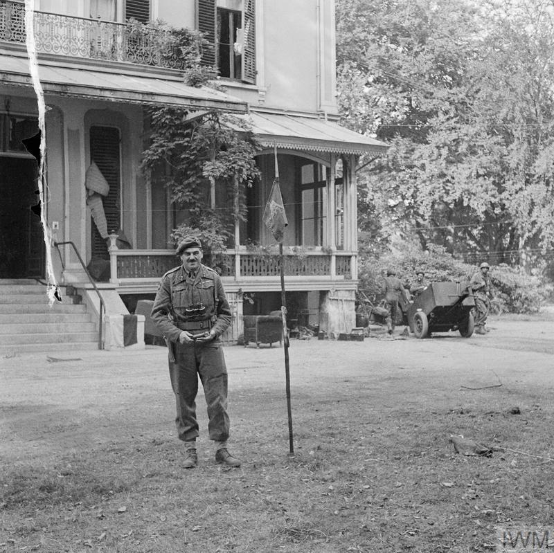 Major-Gen Robert Urquhart, commanding 1st Airborne Division, stands outside his headquarters in Oosterbeek, 22 September 1944.