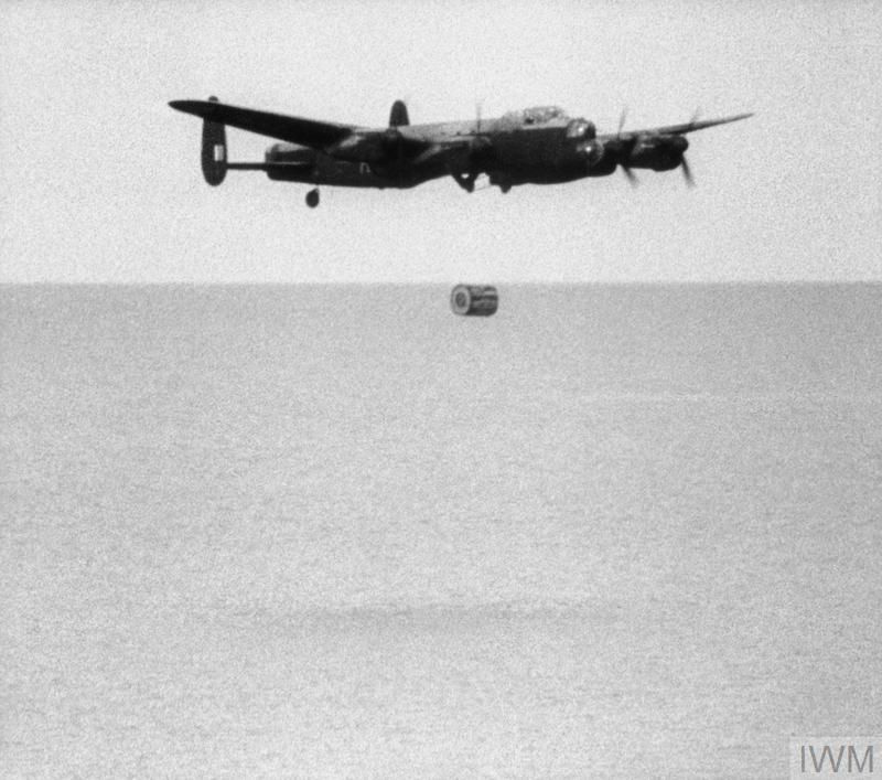 Operation CHASTISE: the attack on the Moehne, Eder and Sorpe Dams by No. 617 Squadron RAF on the night of 16/17 May 1943. No. 617 Squadron practice dropping the 'Upkeep' weapon at Reculver bombing range, Kent. Second launch sequence (3): the bomb falls from the Lancaster as the aircraft begins to climb.