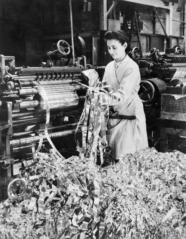 A factory worker producing the strips of aluminium foil for 'Window'
