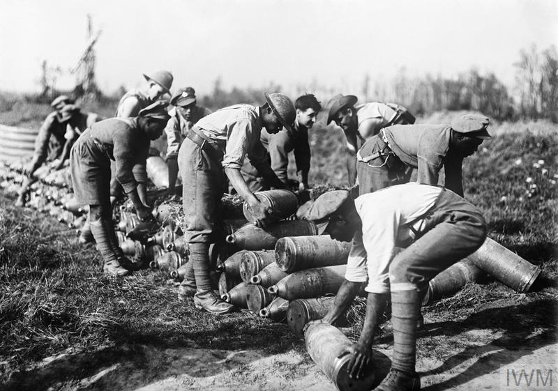 Troops from the West Indies, New Zealand and Australia stacking 8 inch shells at an ammunition dump near Ypres, Belgium, October 1917