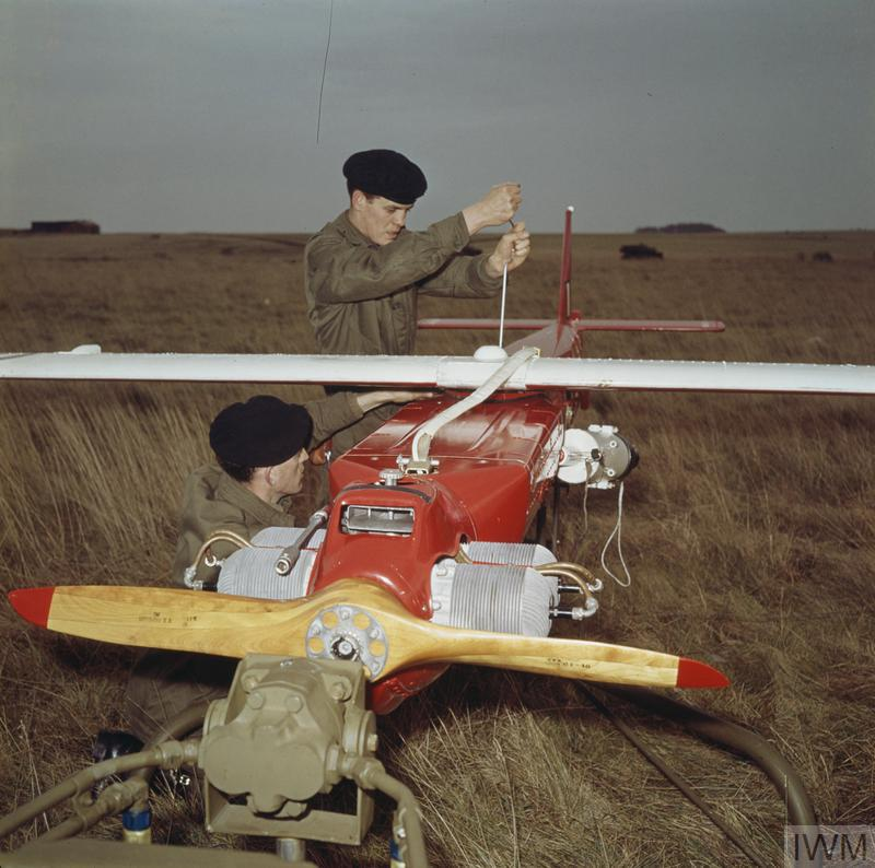 The SDI SURVEILLANCE DRONE SYSTEM: the SDI Drone, now in service, is the first of a family of new drones to be aquired by the Royal Artillery to extend observation over the battlefield and to locate targets for new long range weapons. picture shows: A drone is given a pre-launch check.