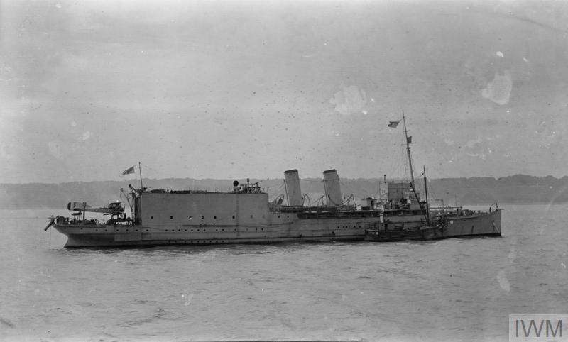 The seaplane carrier HMS ENGADINE at anchor. She was owned by South Eastern and Chatham Railway Company and was attached to Admiral Tyrwhitt's Command, taking part in operations of Heligoland Bight and being present at the air raid on Cuxhaven in 1914.