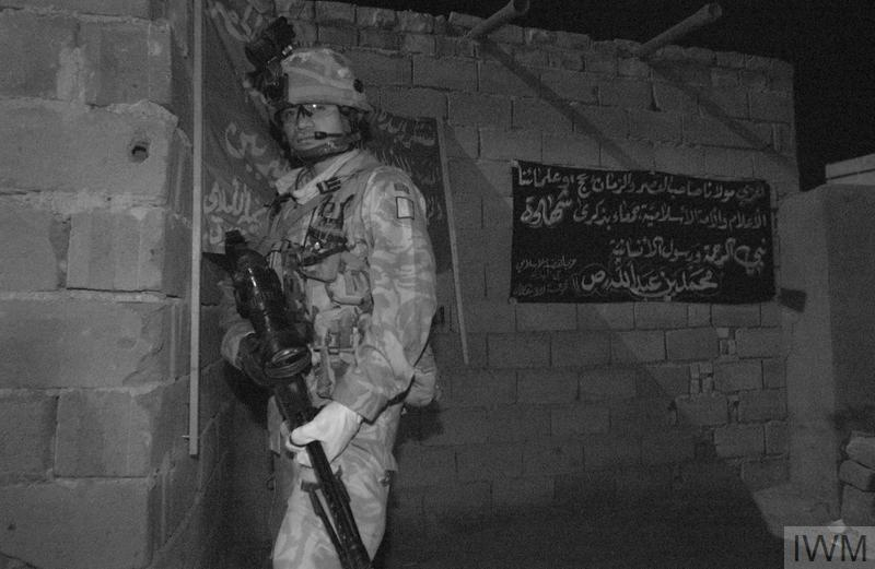 Counter insurgency operations in Basra, 2006. British soldiers, supported by other members of the Multi National Force, carry out a night search and arrest operation in a house in Basra City. The search revealed a cache of arms, ammunition and bombmaking equipment. Fourteen suspected insurgents were arrested.
