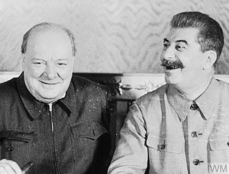 (© IWM (MOI) FLM 1117) The British Prime Minister Winston Churchill and the Soviet leader Joseph Stalin share a joke in the Kremlin, Moscow, in 1942