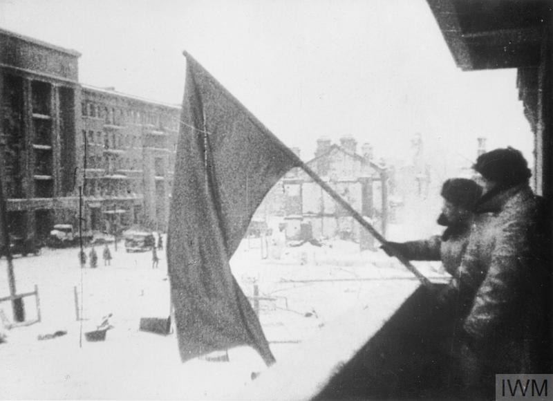 Russian soldiers hoist the Red Flag over a recaptured factory, Stalingrad.