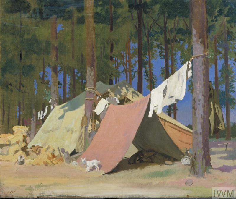 Two tents within a grove of trees, one a makeshift shelter hanging from rope suspended between two trees. A figure lies on the ground resting insdie the tent, his washing hanging to dry in the sun on the same rope as the canvas. There is a stack of supplies to the left, and a small white goat standing against the tent in the sunshine. Beyond the trees there is a deep blue sky.