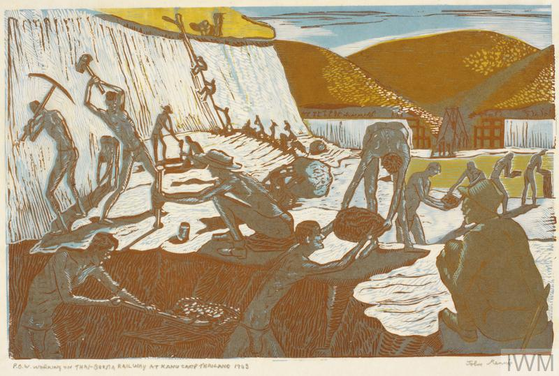 Thin men suffering from starvation are shown at work in a valley. In the foreground a man is digging at the face of a bank, with another passing a boulder to a fellow POW, and a chain of men passing rocks behind. To the centre-left a man is hitting a metal pole into the ground with a mallet, whilst another man holds the pole in place. To the far back left, men are working at the face of a hill, and some men shown climbing the face by rope. Part of the railway structure can be seen in the background, against
