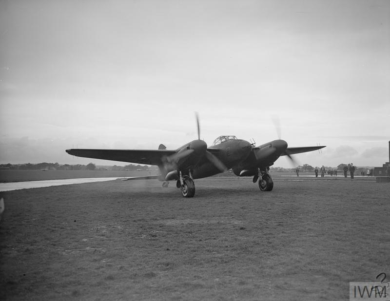 One of the first Mosquito II night-fighters, seen after a demonstration flight during a visit by the Duke of Kent to the de Havilland plant at Hatfield in November 1941 The nose-mounted transmitter aerial and wing-mounted receiver aerials for the aircraft's AI Mk IV radar are visible.