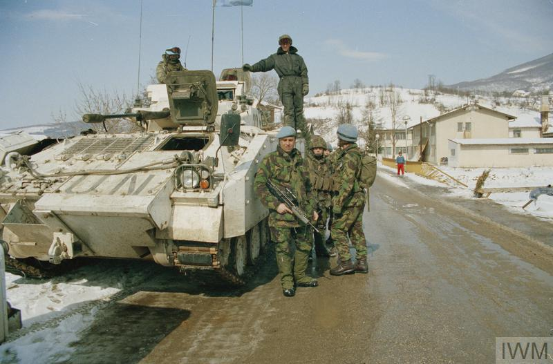 Soldiers from 'B' Company of the 2nd Battalion, Royal Irish Regiment (Rangers) with a Warrior FV510 in the town of Gornji Vakuf.