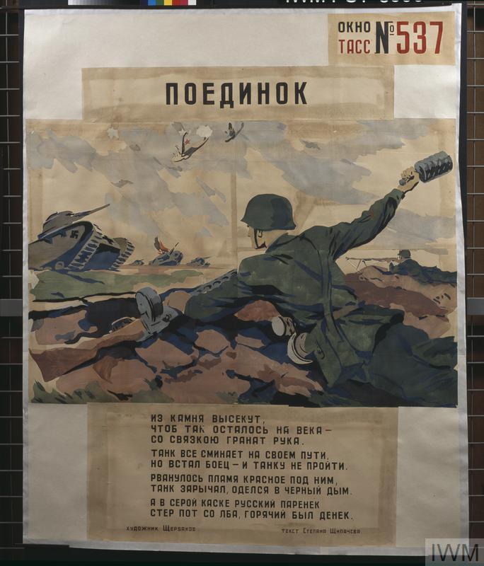 [Tass Window 537] Russian soldier throwing stick grenade