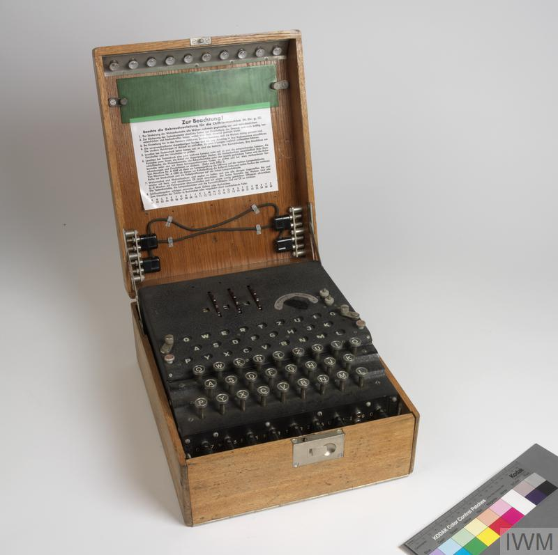 © IWM (COM 22) The Enigma was an electro-mechanical enciphering machine, ultimately produced in large quantities for the German Armed Forces. Invented in 1923, the first models were marketed for commercial company use, as a counter to industrial espionage