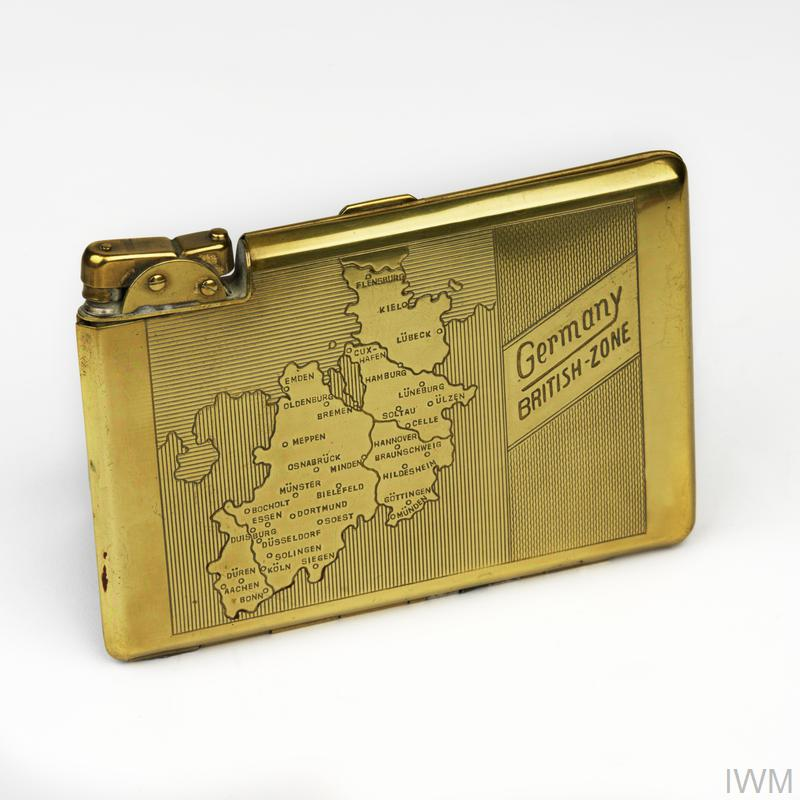 brass cigarette case-lighter (H 8.7cm x W 12cm) bearing engraved markings: on one side: 'Germany BRITISH ZONE'; and on the other a post-Second World War map of British occupation zone in Germany.