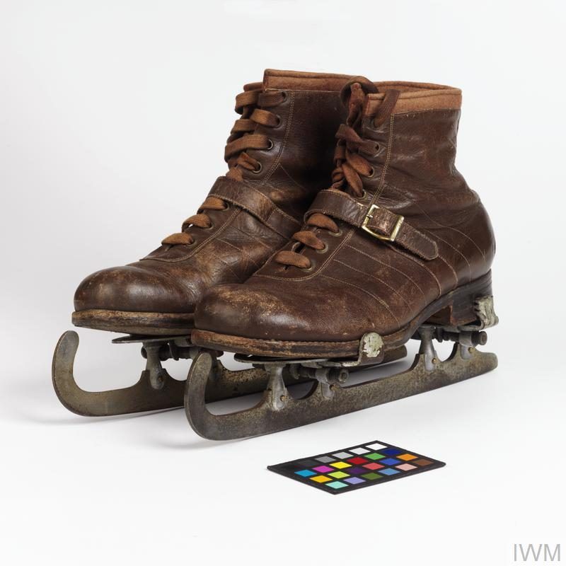 Boots with clip-on skates worn by Herbert Kay