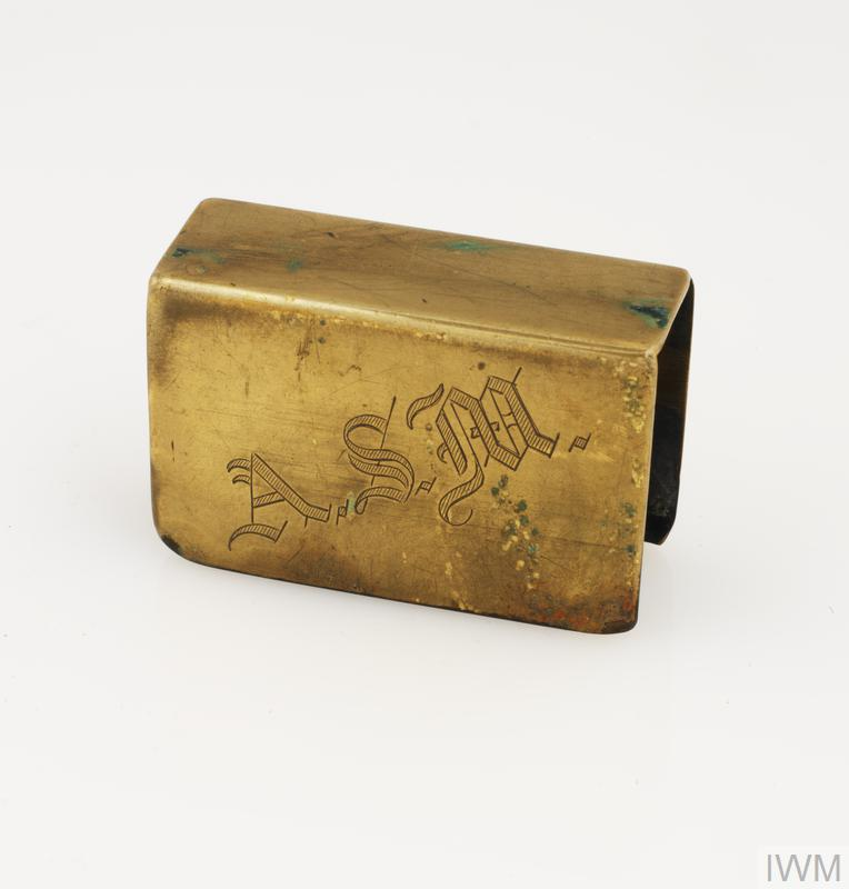 Trench art matchbox cover made of brass and decorated with the cap badge of the Royal Canadian Artillery (RCA).