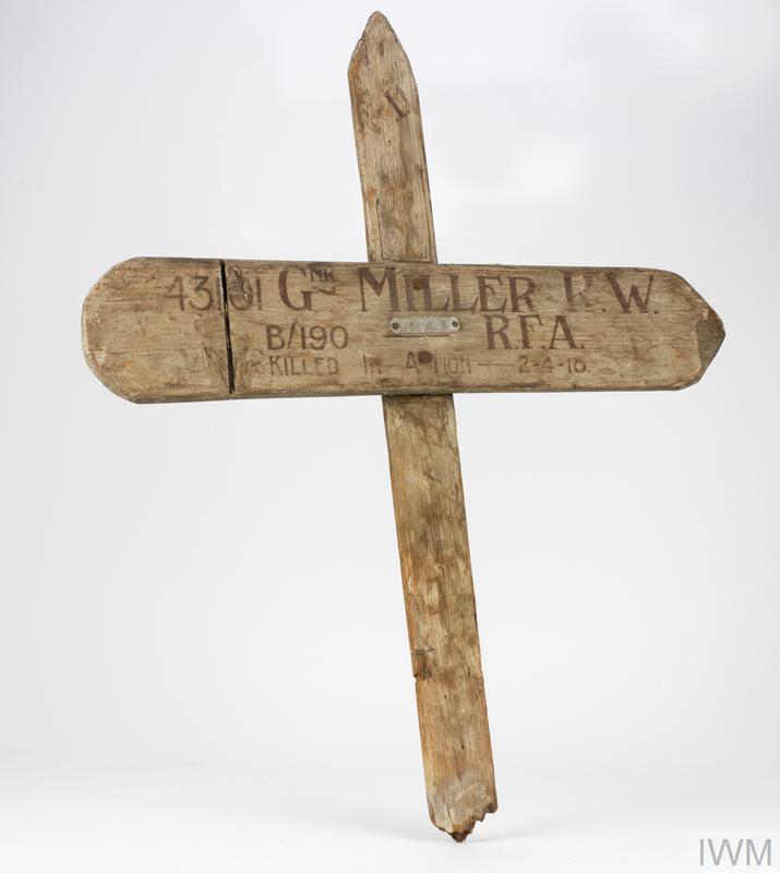 Wooden cross inscribed with the deceased's name.